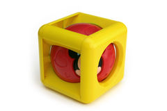 Infant musical cube. Hollow cube with a musical spinning sphere within Stock Photos