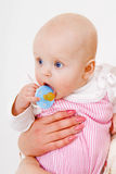 Infant with a pacifier Royalty Free Stock Photos