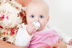 Infant with a pacifier Stock Image