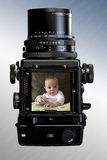 Infant Photographed With Camera. An infant child photographed with a medium format camera Royalty Free Stock Images