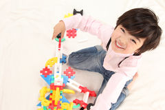 Infant play. Asian boys play with toys Royalty Free Stock Image