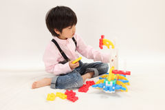 Infant play. Asian boys play with toys Royalty Free Stock Images