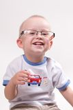 Infant playing with glasses Stock Image