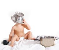 Infant playing with kitchen utencils Royalty Free Stock Photo