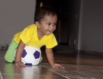 Infant Playing Soccer Stock Photo