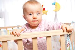 Infant in playpen. Sulking baby in the playpen Royalty Free Stock Images