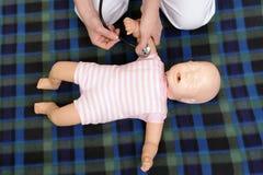 Infant pulse checking demonstration stock image