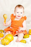 Infant with pumpkin Stock Photos