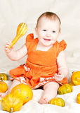 Infant with pumpkin Stock Image