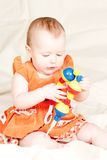 Infant with rattle Royalty Free Stock Image
