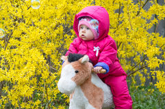 Infant ridding horse. Infant ridding toy cottony horse rocking on spring bush royalty free stock photos