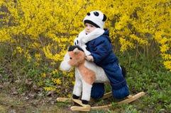 Infant ridding horse. Infant ridding toy cottony horse rocking on spring bush stock photography