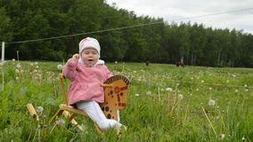 Infant rocking horse. Cute infant girl rocking baby horse outdoor stock video