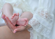 Infant's cute feet Stock Images
