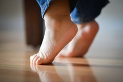 Infant's Precious Feet On Tippy Toes - Innocence Concept Royalty Free Stock Photo