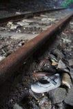 Infant's Shoe On Railway Track Stock Photos