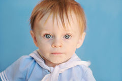 Infant Sailor Boy. Infant redhead boy with big blue eyes in sailor outfit stock images