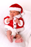 Infant Santa. In coat Royalty Free Stock Photos