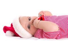 Infant santa. Christmas baby - newborn girl wearing as Santa on white Royalty Free Stock Photos