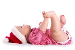 Infant santa. Christmas baby - newborn girl wearing as Santa on white Royalty Free Stock Photo