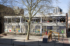 Infant school or kindergarten. Streetview in city with Infant school or Kindergarten and school yard on day in early spring Royalty Free Stock Photos