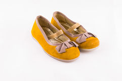Infant Shoe. Pair of child shoes indoor type dancer with gold bows on the toe and elastic rubber bondage stock images