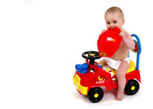 Infant sitting on push toy Royalty Free Stock Image