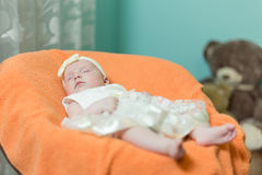 Infant sleeps in the armchair for toddlers. Royalty Free Stock Images