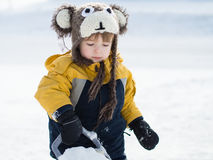Infant in the snow Stock Images
