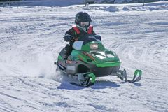 Infant snowmobile racer Stock Photo