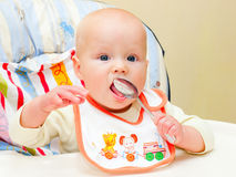 Infant with spoon Royalty Free Stock Image