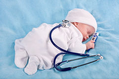The infant with a stethoscope Stock Photography