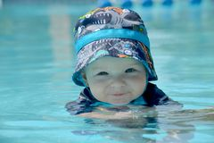 Baby Swimming with Hat Royalty Free Stock Photo