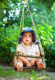 Infant on a swing Stock Images