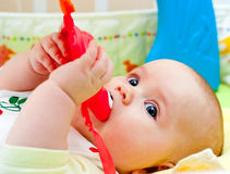 Infant with teething toy Royalty Free Stock Photography