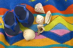 Infant Tiny Blue Sandals on Beach Towel Stock Photo