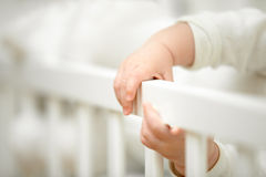 Infant tiny hands in the crib Stock Photography