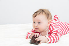 Infant touching smart phone Royalty Free Stock Image