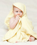 Infant in towel Stock Photo