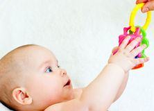 Infant with toy Stock Images
