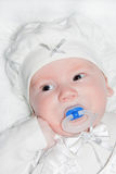 Infant about two month in white suit Stock Images