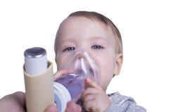 Infant using asthma inhalator Royalty Free Stock Photography