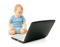 Infant using laptop Stock Photography