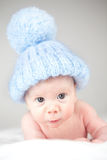 Infant wearing blue knit hat. With a white background Stock Photography