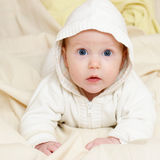 Infant wearing hood Stock Photos