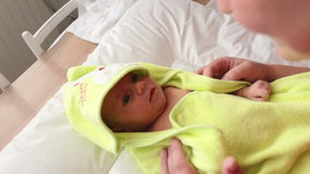 Infant wrapped in a towel after bath stock video