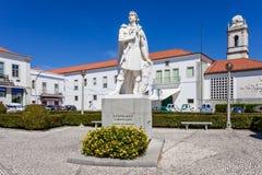 Infante Santo Statue. In background, the Escola Pratica de Cavalaria Royalty Free Stock Image