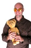 Infantil guy. Grin with his teddy bear Royalty Free Stock Images