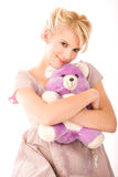 Infantile smiling blonde. With a teddy bear Stock Photography
