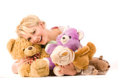 Infantile smiling blonde. With a lot of toys Stock Images
